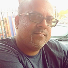 K. Surujbally